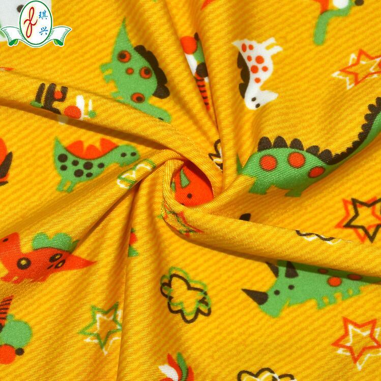 儿童卡通恐龙印花纹泳装布料